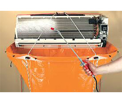 Split System Air conditioner being cleaned